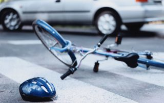Helmet,And,Bike,Lying,On,The,Road,After,A,Car (Bike-accident)