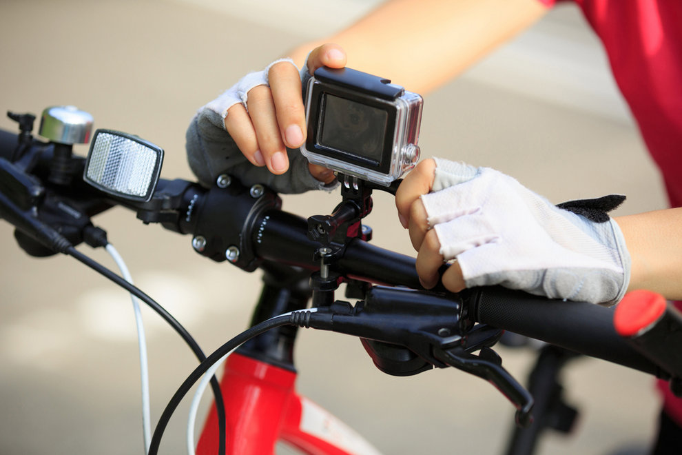 Cyclist Setting Camera on Bike - Why Bicyclists Should Ride With a Camera