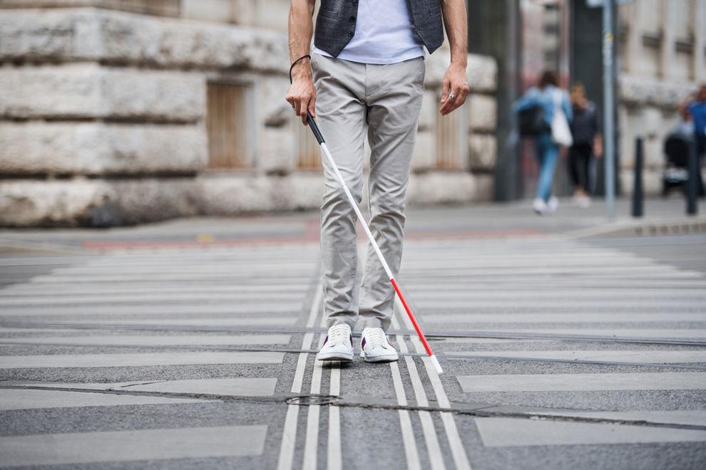 Blind man crossing street
