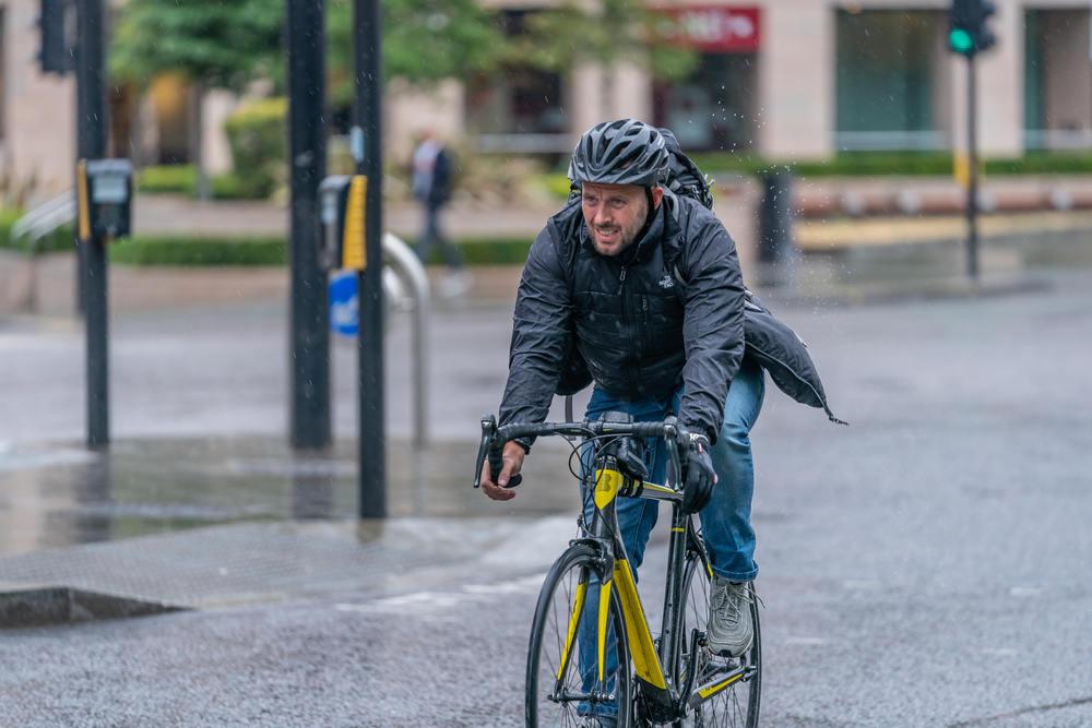Man cycling in the rain