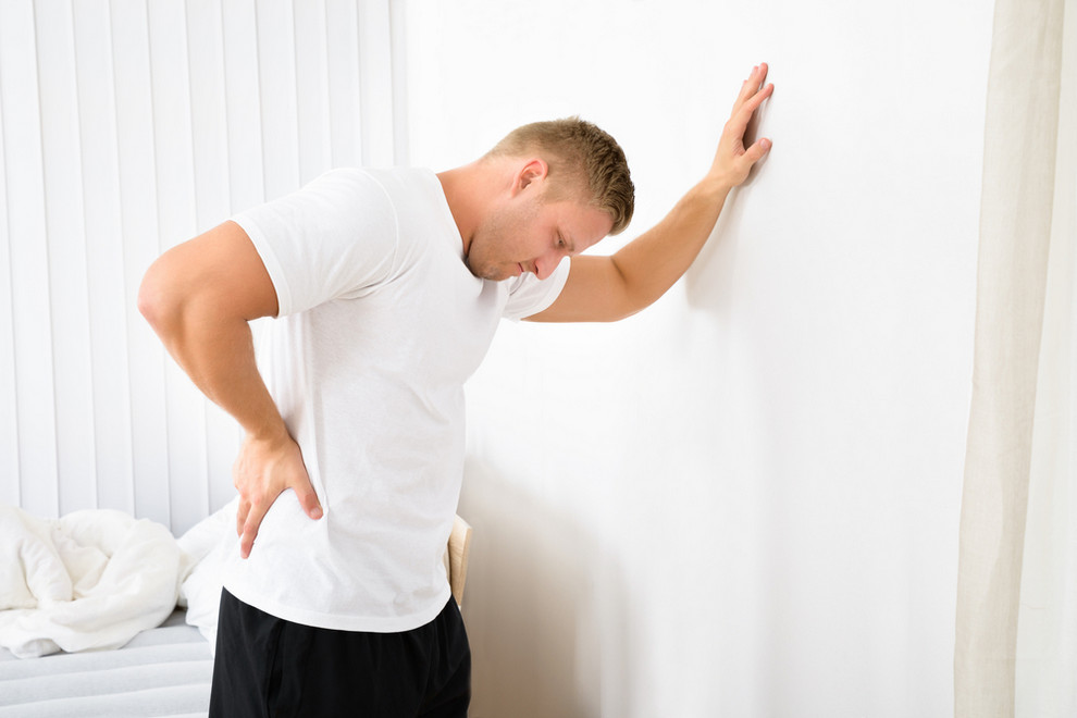 Man suffering from a spine disorder