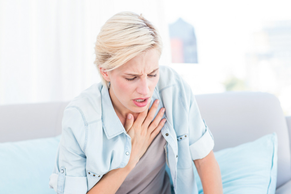 Woman Suffering From Respiratory System Disorders