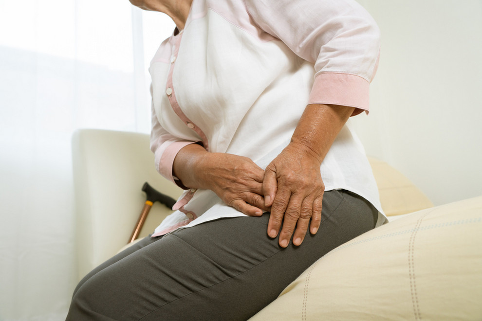 Woman with hip pain - Hip Disorders