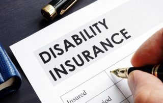 Man is filling in Disability insurance form (Is Long Term Disability Taxable)